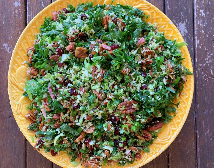 Shredded Brussels sprouts with crispy pancetta, cranberries & glazed pecans